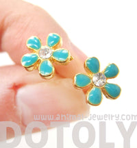small-daisy-floral-flower-shaped-stud-earrings-in-blue-on-gold-with-rhinestones
