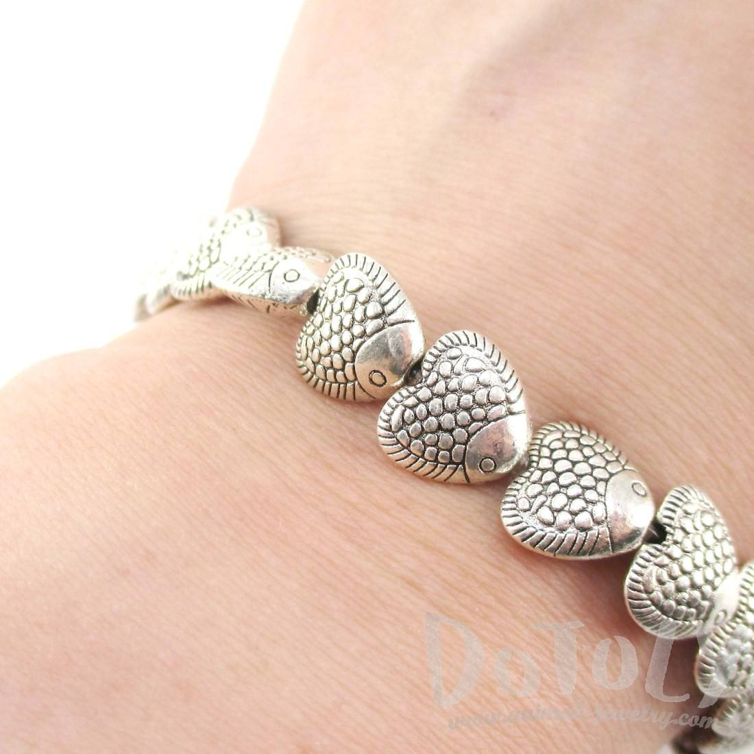 A Row Of Fish Shaped Beaded Stretchy Bracelet in Silver