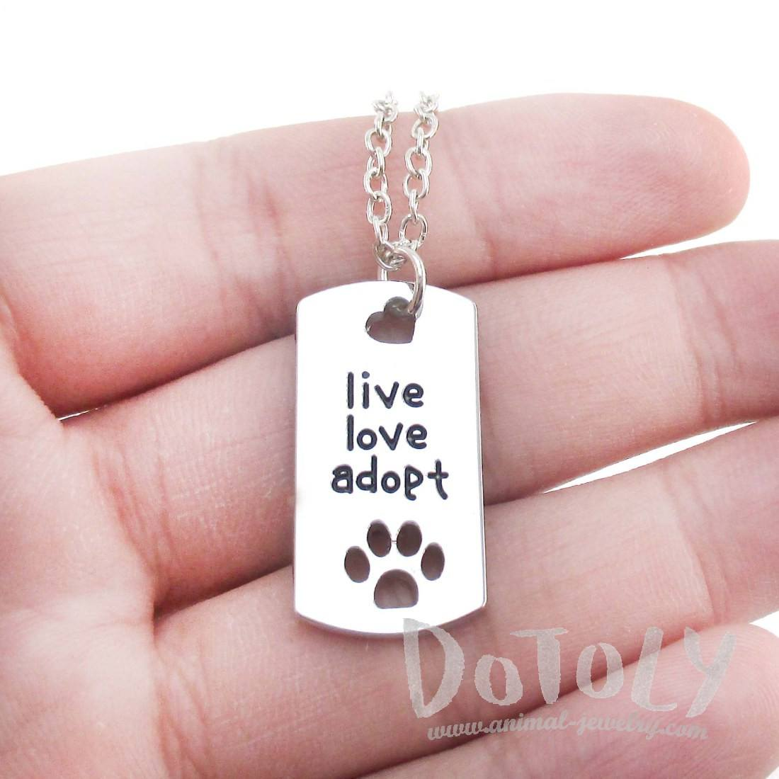 """Live Love Adopt"" Dog Tag Shaped Paw Print Pendant Necklace in Silver"