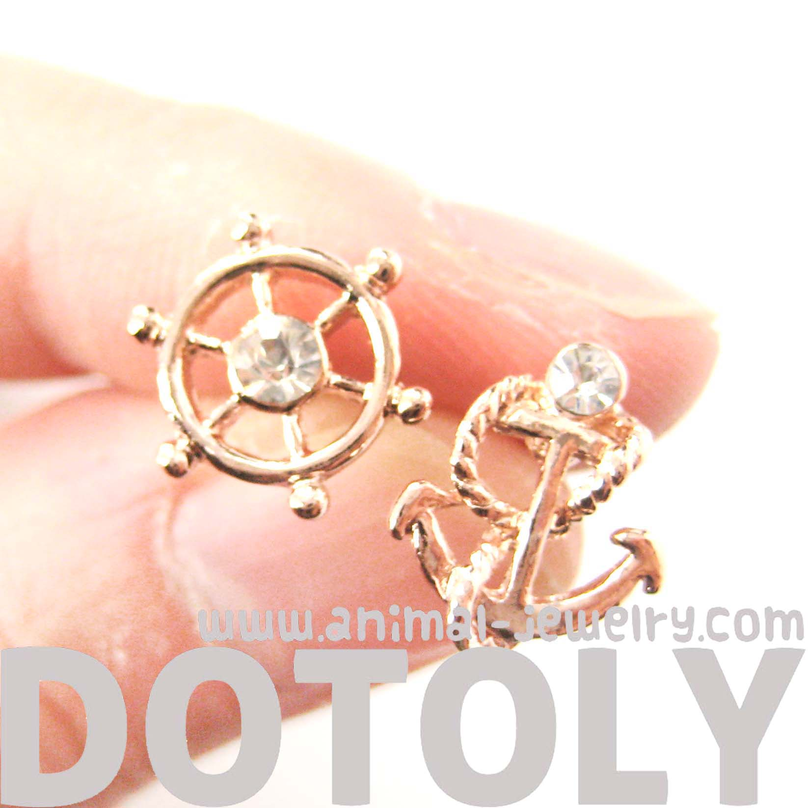nautical-themed-anchor-and-wheel-shaped-stud-earrings-in-rose-gold