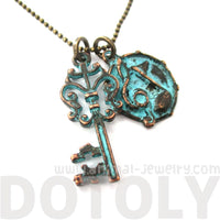Skeleton Key and Musical Notes Charm Necklace in Brass