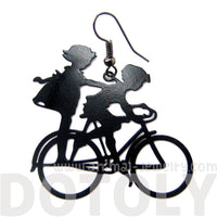 Boy and Girl Sharing a Bicycle Silhouette Dangle Earrings in Black