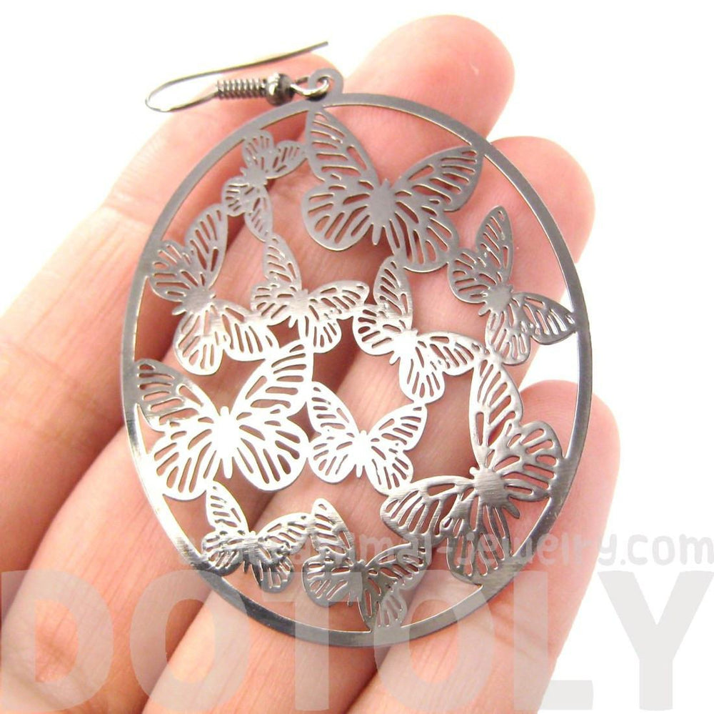 Butterfly Outline Cut Out Disc Shaped Dangle Drop Earrings in Silver
