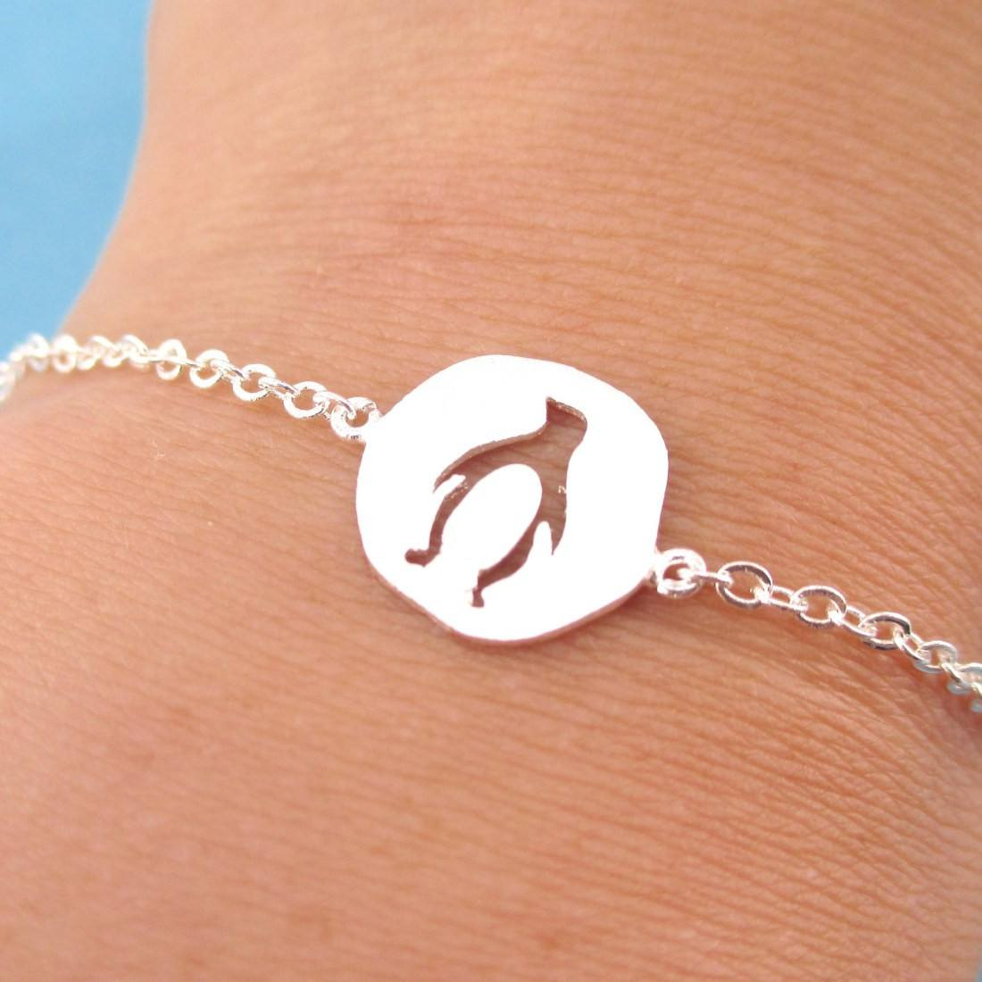Charm Bracelet with Penguin Silhouette Cut Out in Silver | DOTOLY