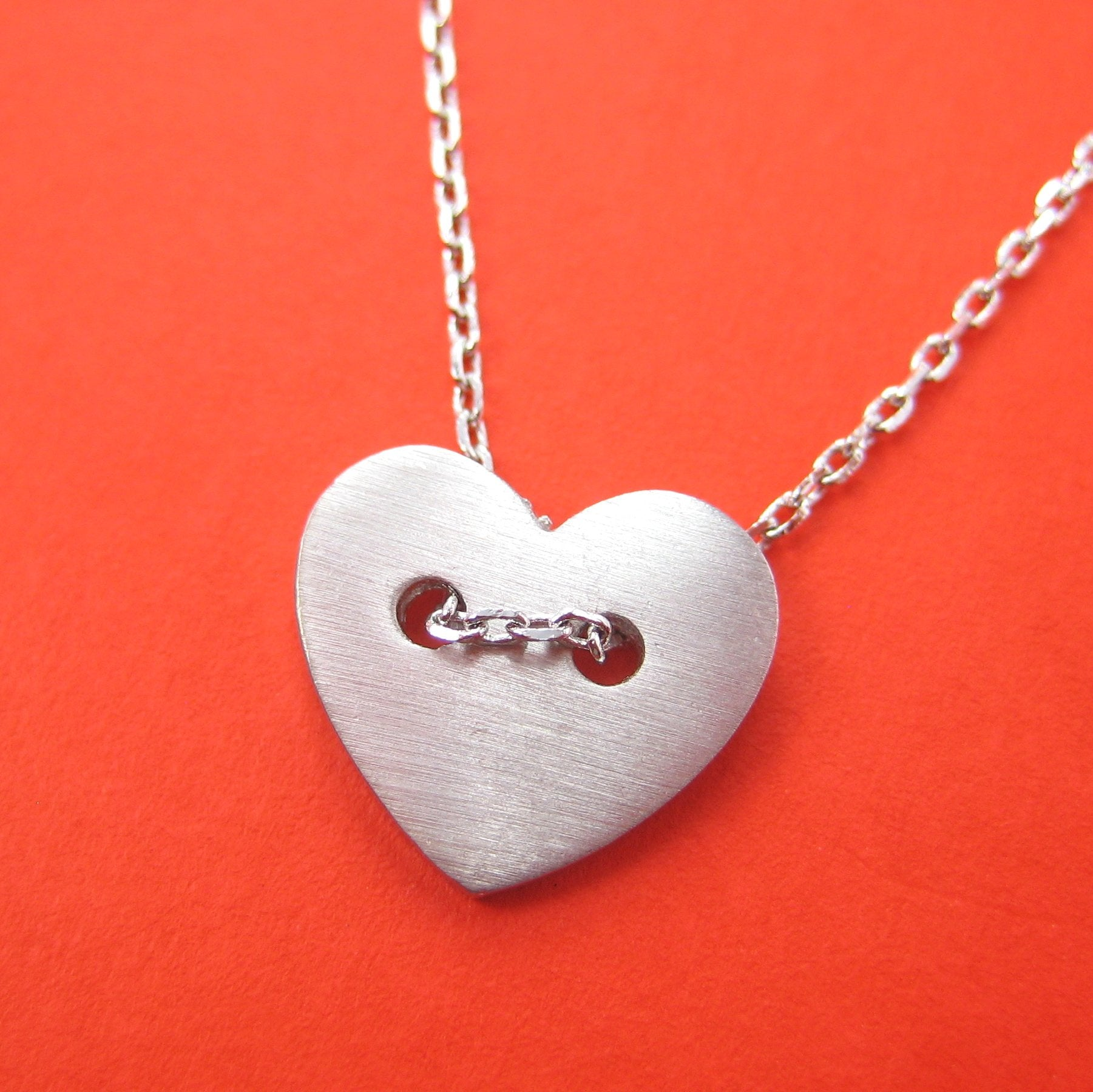 simple-heart-shaped-button-love-charm-necklace-in-silver