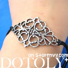 floral-art-nouveau-inspired-charm-bracelet-in-silver