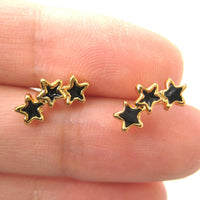 small-connected-stars-stud-earrings-in-black-on-gold
