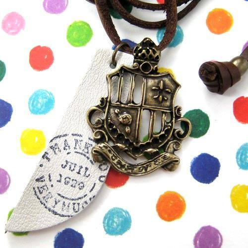 antique-crest-badge-shield-charm-necklace-leather-ink-print-tag