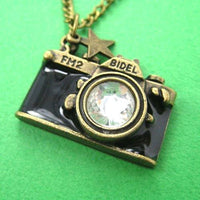 camera-photographer-necklace-in-black-on-bronze-with-rhinestone-lens