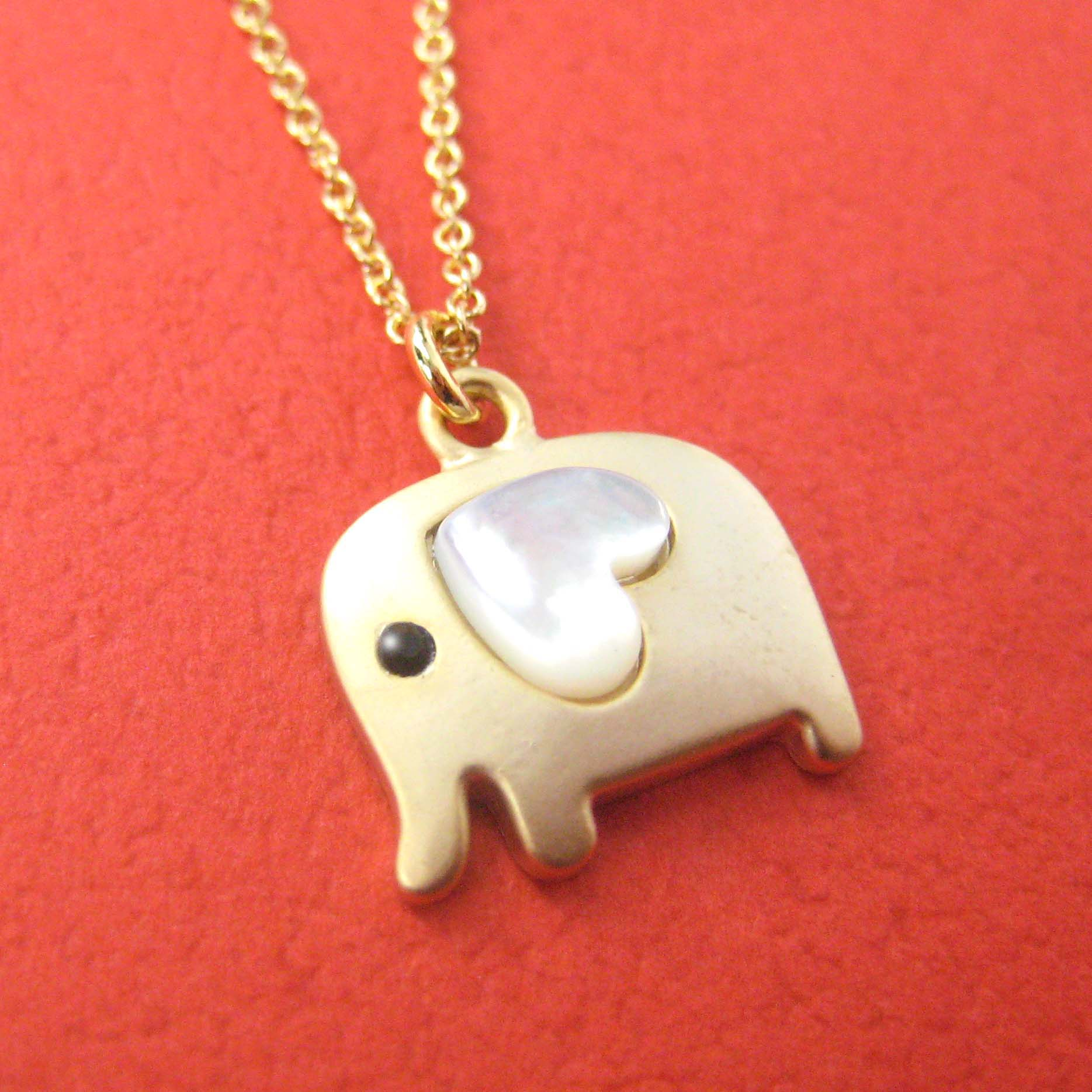 small-elephant-animal-necklace-in-gold-with-heart-allergy-free