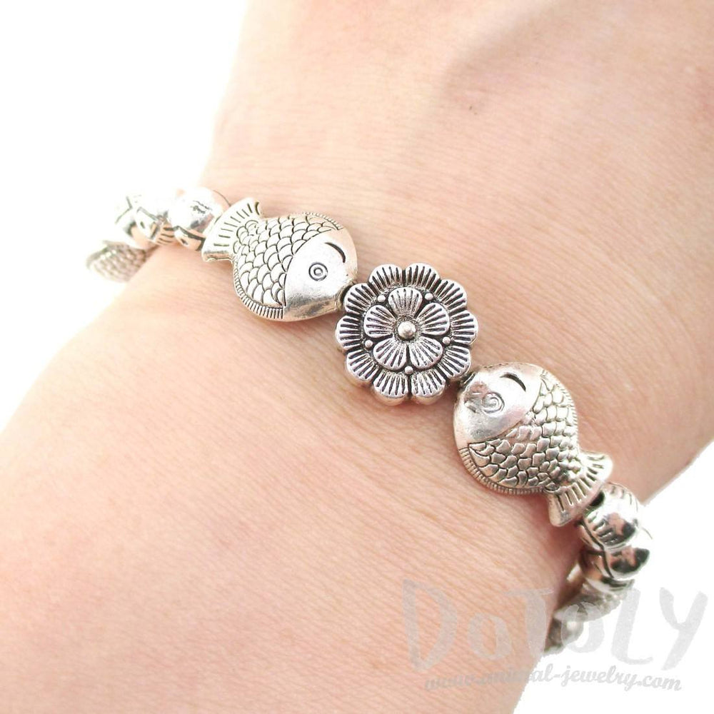Fishes and Flowers Shaped Beaded Charm Stretchy Bracelet in Silver | DOTOLY | DOTOLY
