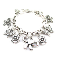 Flowers Butterflies and Bows Charm Bracelet in Silver