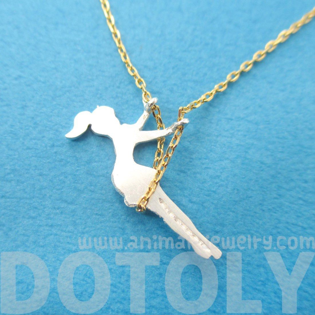 Girl Swinging on a Swing Acrobat Charm Necklace in Gold and Silver