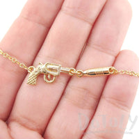 Gun and Bullet Revolver Shaped Charm Necklace in Gold | DOTOLY | DOTOLY