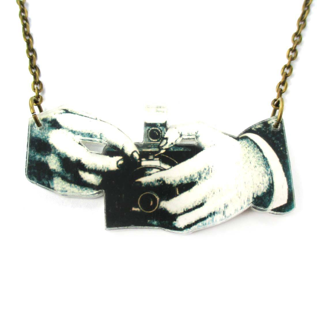 Hands Holding a Vintage Camera Shaped Acrylic Pendant Necklace