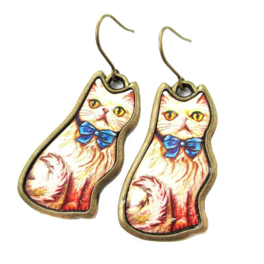 Fancy Kitty Cat Animal Dangle Earrings in White with Blue Bow | DOTOLY