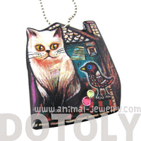 Kitty Cat in Front of A House with a Bird Shaped Pendant Necklace