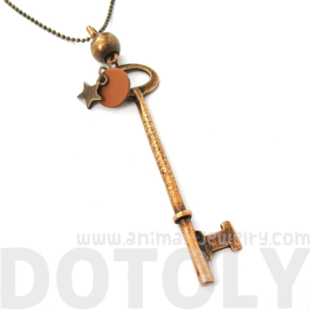 Long Skeleton Key and Star Shaped Pendant Necklace in Brass
