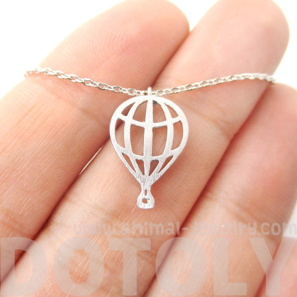 Miniature Hot Air Balloon Shaped Cut Out Charm Necklace in Silver | DOTOLY | DOTOLY