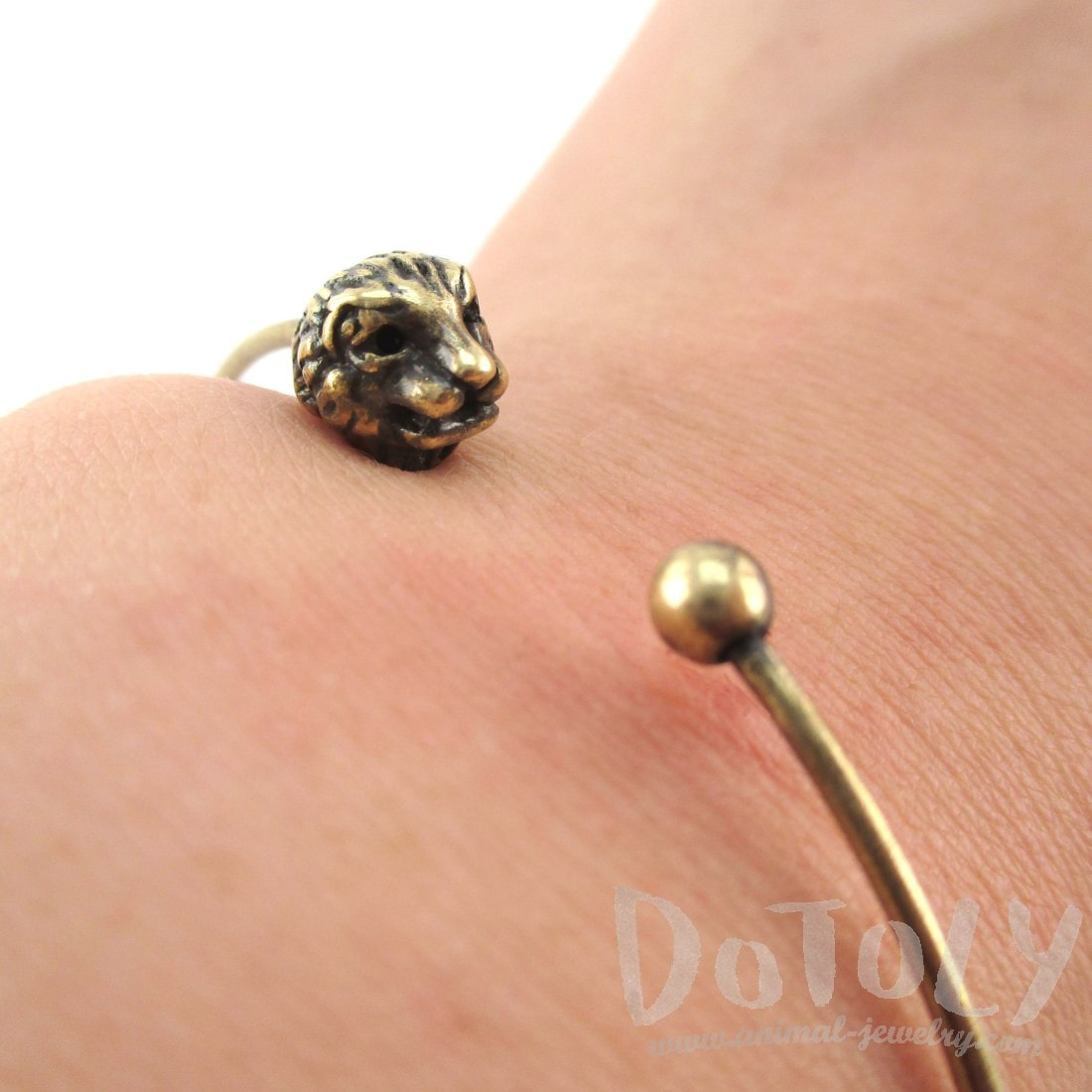 Minimal Bangle Bracelet Cuff with Lion Head Detail in Brass | DOTOLY