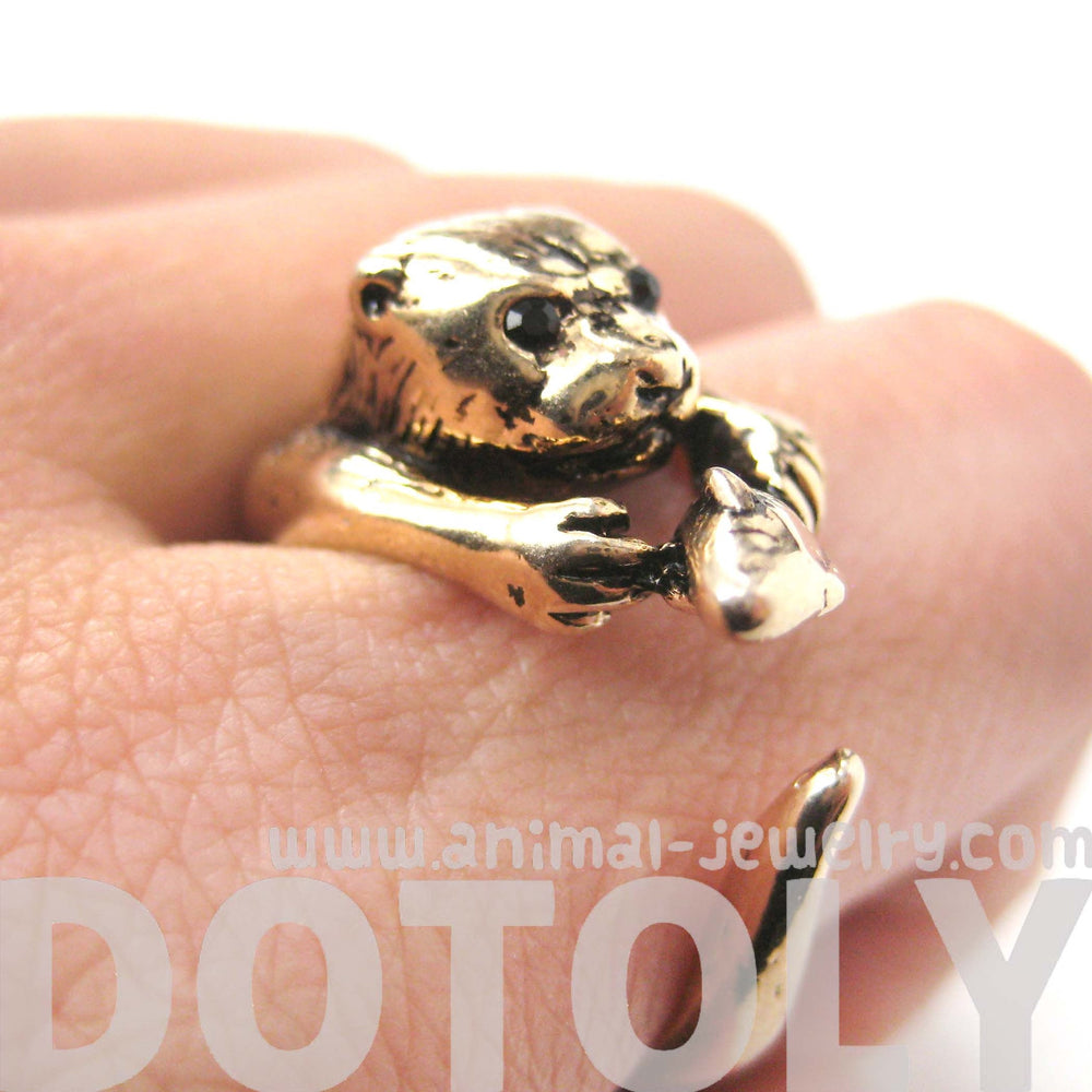 Otter Holding a Fish Shaped Animal Wrap Around Ring in Shiny Gold