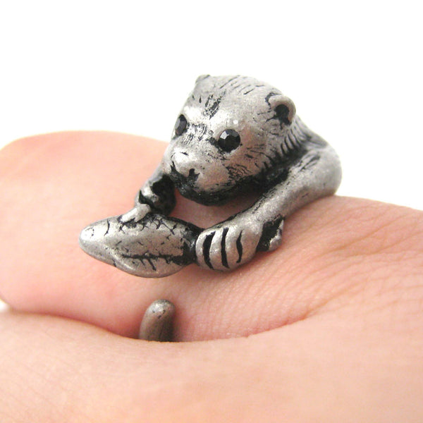 Otter Holding a Fish Shaped Animal Wrap Around Ring in Silver | DOTOLY