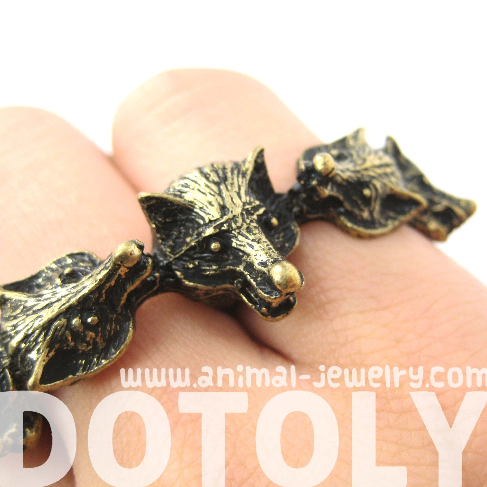 pack-of-wolves-shaped-double-duo-finger-animal-ring-in-brass-dotoly