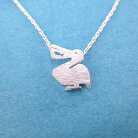 Pelican Silhouette with Fish Cut Out Shaped Charm Necklace in Silver | DOTOLY | DOTOLY