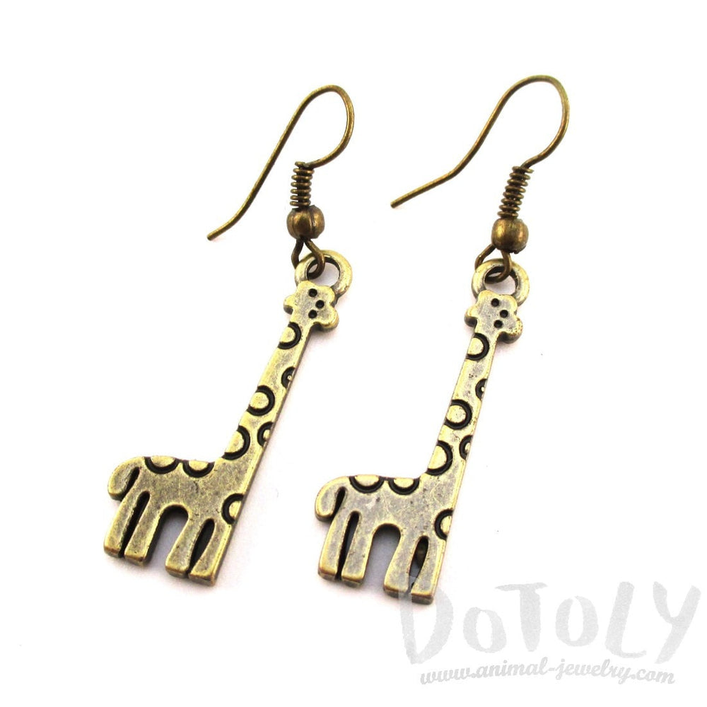 Polka Dotted Giraffe Shaped Dangle Charm Earrings in Brass | DOTOLY