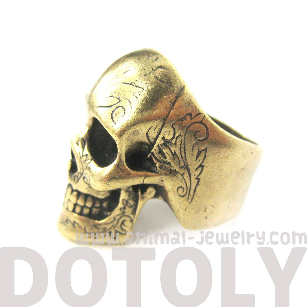realistic-skull-skeleton-shaped-unisex-ring-with-tattoo-details-in-brass-dotoly