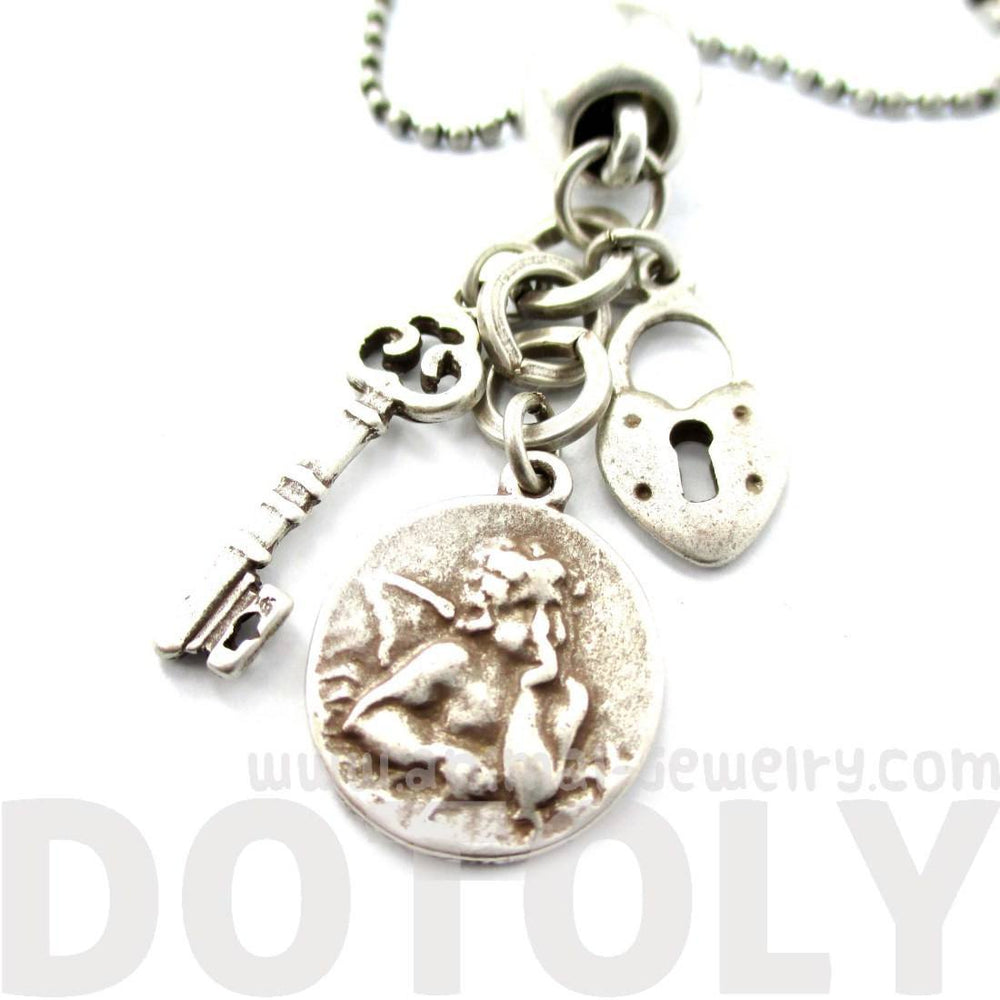 Romantic Themed Skeleton Key Heart Shaped Lock and Angel Coin Shaped Charm Necklace in Silver | DOTOLY