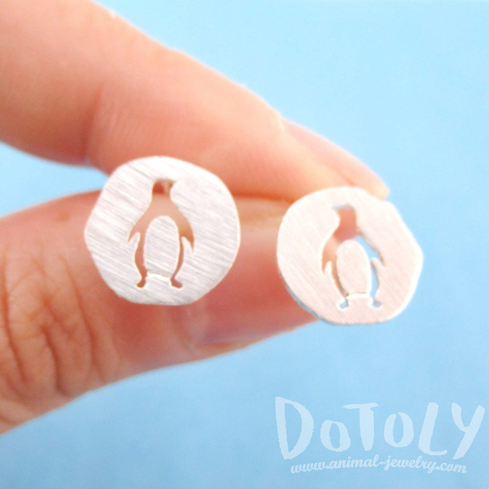Round Silver Stud Earrings with Penguin Silhouette Cut Out in Silver