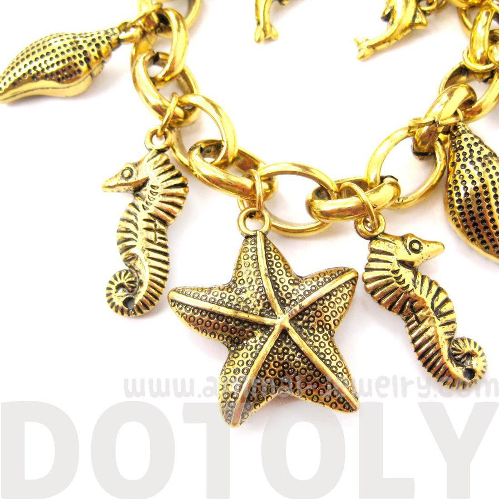 Sea Creatures Starfish Seahorse Dolphins Themed Charm Bracelet in Gold