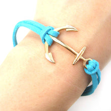 simple-nautical-anchor-shaped-pendant-bracelet-in-gold-on-turquoise-dotoly