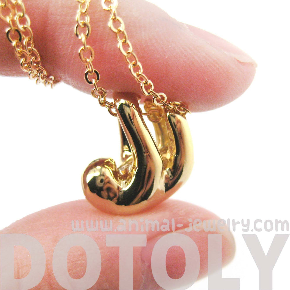 sleek-abstract-sloth-shaped-animal-pendant-necklace-in-gold-dotoly