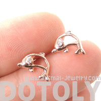 small-dolphin-fish-sea-animal-outline-stud-earrings-in-rose-gold-dotoly