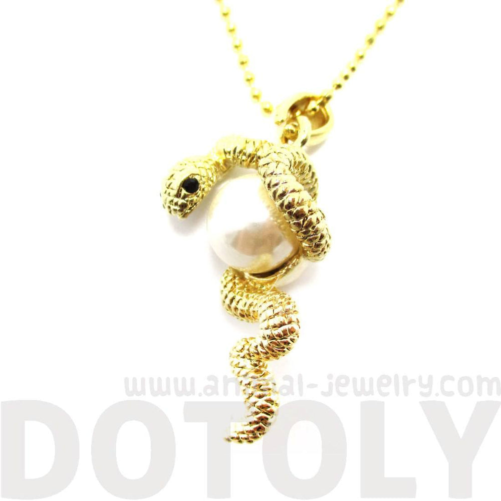 Snake Wrapped Around a Pearl Shaped Necklace in Gold
