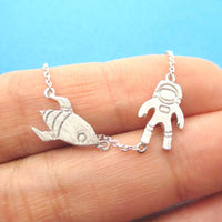 Spaceship and Astronaut Space Travel Themed Charm Necklace in Silver | DOTOLY | DOTOLY