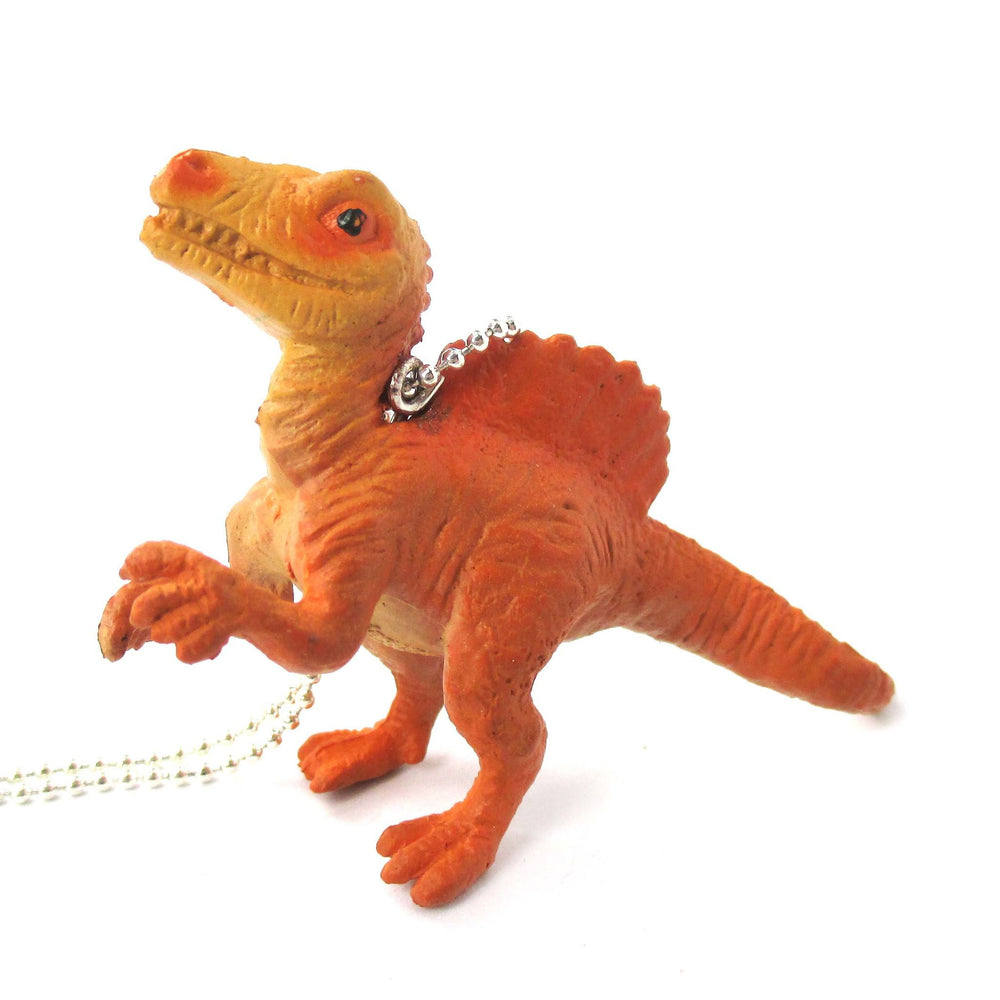 Spinosaurus Dinosaur Shaped Figurine Pendant Necklace in Orange | Animal Jewelry | DOTOLY