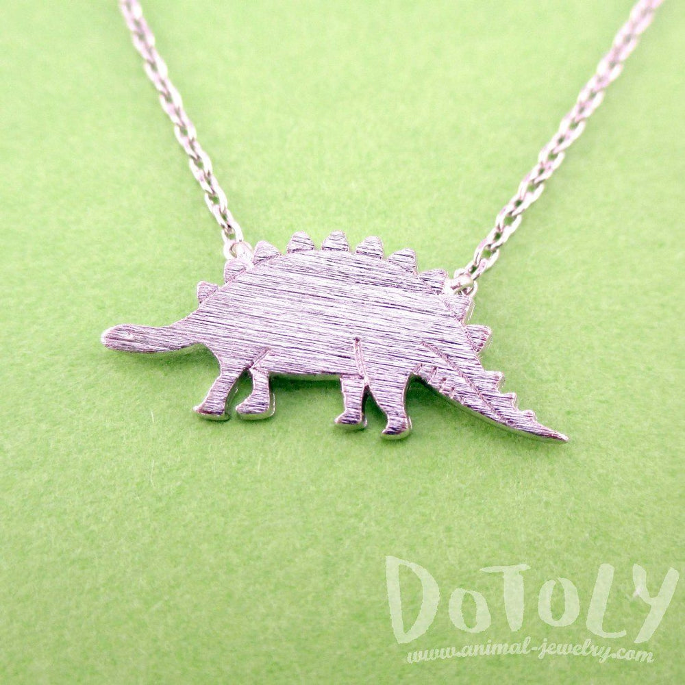 Stegosaurus Dinosaur Silhouette Jurassic World Themed Charm Necklace in Silver | DOTOLY