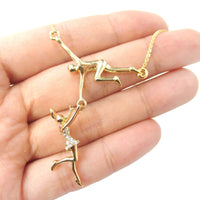 Trapeze Acrobat Pendant Circus Themed Necklace in Gold