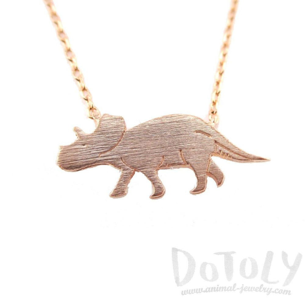 Triceratops Dinosaur Silhouette Jurassic World Themed Charm Necklace in Rose Gold | DOTOLY