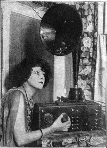 woman tuning radio