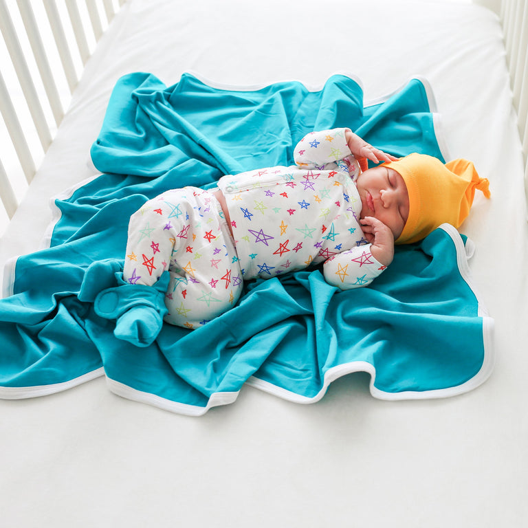 RAINBOW STAR COMING HOME SET ON BABY LYING ON BLANKET