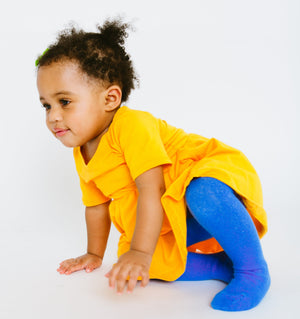 CHILD SHOWN WEARING COBALT BABY KNIT TIGHTS