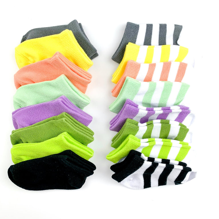 SHORT SOCKS LINED UP IN SOLIDS AND STRIPES ON A WHITE BACKGROUND