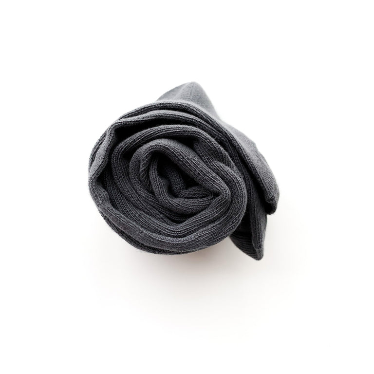 CHARCOAL SOLID KNIT TIGHTS ROLLED UP ON A WHITE BACKGROUND