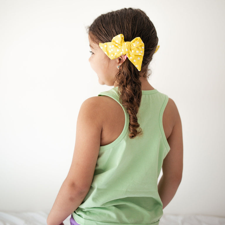 Lemon with Snow Dot everyday bows shown on child