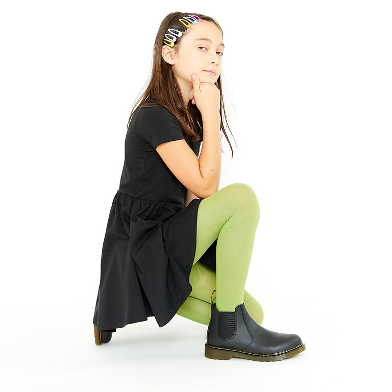 AVOCADO TIGHTS SHOWN ON CHILD KNEELING WITH ONE KNEE UP AND HEAD RESTING ON CLOSED HAND