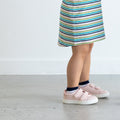 Thumbnail for navy short sock stripe set shown on child standing, paired with light pink shoes and our retro stripe hi-lo dress